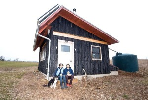 (12/29/14) - (Harrisonburg) ---- Meghan Williamson Kurt Rosenberger and their pet dog at the tiny house on Switchboard Road. (Daily News-Record/Michael Reilly)